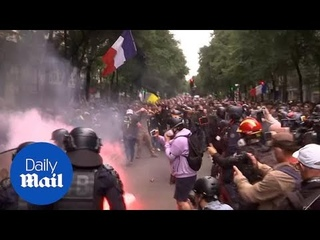 Clashes erupt in Paris with protestors over new restrictions