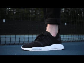 On feetadidas nmd runner primeknit black