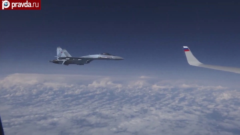 Two Sukhoi Su-27 chase F-18 away from Russian Defense Minister's plane