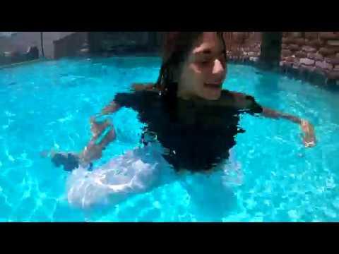 Wetlook beautiful girl in pool