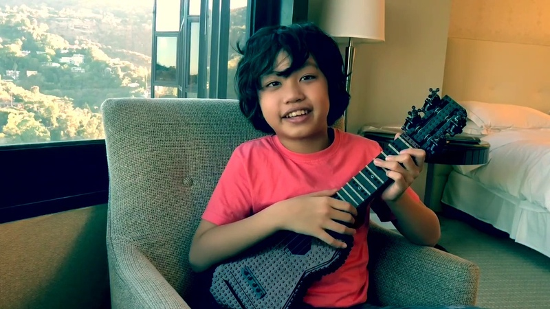 Feng E plays the LEGO ukulele for Ellen