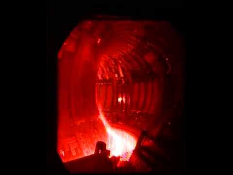 Firing frozen fuel pellets into hot plasma
