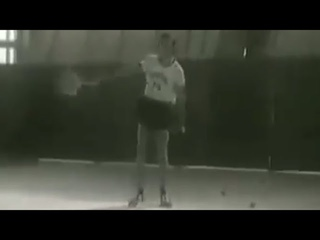 Anatoly Karpov playing tennis as part of the preparation for his match against Bobby Fischer